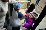 At the Jeremiah Program in St. Paul, Sinying Lee picked up her youngest child Cattleya,3. The older kids Benjamin,4, and Pashalia,5, came along for th