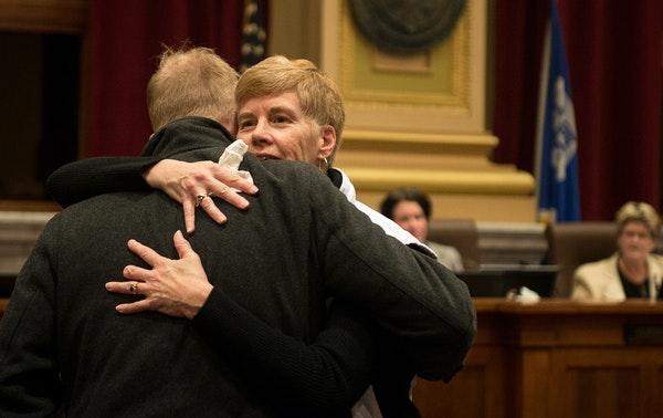 Minneapolis Park Board Commissioner Jon Olson hugged superintendent Jayne Miller before the start of the 2017 City Council meeting where Miller's resi