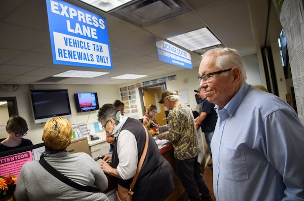 Deputy Register 035 Vinton Lewis and his wife, Janet, run the South Saint Paul Quick-Serv License Center. They have had to take tens of thousands of d