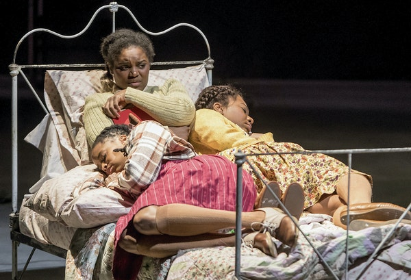 """Carla Duren (Claudia), Brittany Bellizeare (Pecola) and Deonna Bouye (Frieda) in the Guthrie Theater's """"The Bluest Eye."""""""
