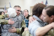 Soldiers with the 257th Military Police Company were greeted by family members Wednesday after arriving in Monticello, Minn., following a nine-month d