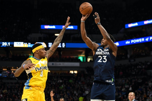 Timberwolves guard Jimmy Butler attempted a three-pointer but was fouled by Nuggets guard Torrey Craig in the second quarter. Butler finished with a g