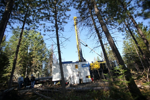 In this file photo, a drill rig digging for Twin Metals was working in the woods near Ely, Minn.