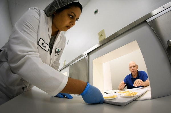 Cargill sensory specialist Nisa Tharayil prepared the morning test for the 14 test subjects who each receive two sets of three numbered plates of frie