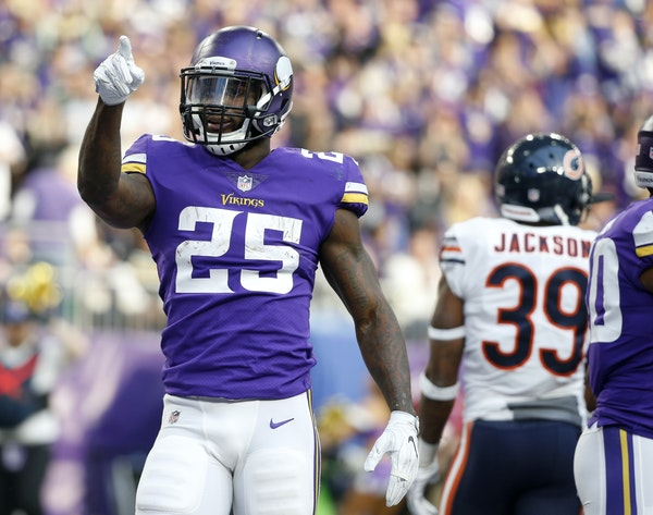 Minnesota Vikings running back Latavius Murray celebrates after scoring on a 1-yard touchdown run during the first half of an NFL football game agains