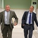 Stephen Frenz, right, and attorney Douglas Turner walked through City Hall in Minneapolis in September.