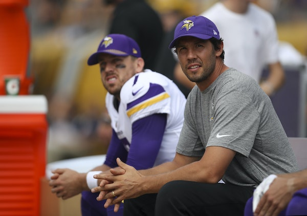 Injured Minnesota Vikings quarterback Sam Bradford, foreground, sat on the bench with his backup, quarterback Case Keenum during the Steelers' first s