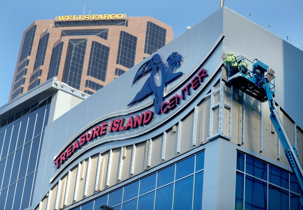 The Treasure Island Center building had its grand opening on Tuesday in St. Paul. Here, workers were putting the finishing touches on the exterior.