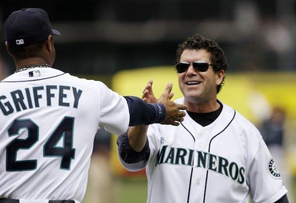 Former Seattle Mariners designated hitter Edgar Martinez, right, in 2009.