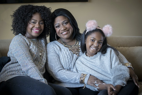 """Paris Bennett, left, with her mother, Jamecia — who's co-starring as Glinda the Good Witch in """"The Wiz"""" — and daughter, Egypt."""