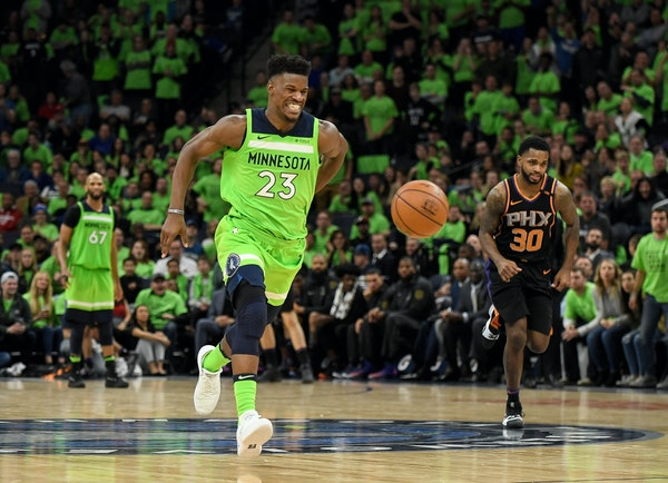 Jimmy Butler winced while holding his back as he broke away for a dunk against the Suns on Dec. 16, a tough 108-106 home loss that led to the Wolves w