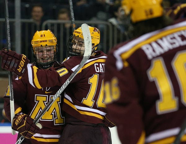 The Gophers Brent Gates Jr., center, celebrated his goal against Michigan State last Saturday with teammates Casey Mittelstadt, left, and Jack Ramsey.