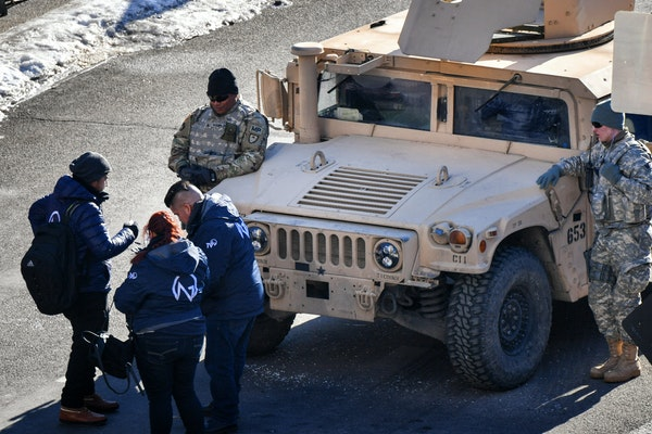 Military police in humvees guard the entrance to the Minneapolis Convention Center.