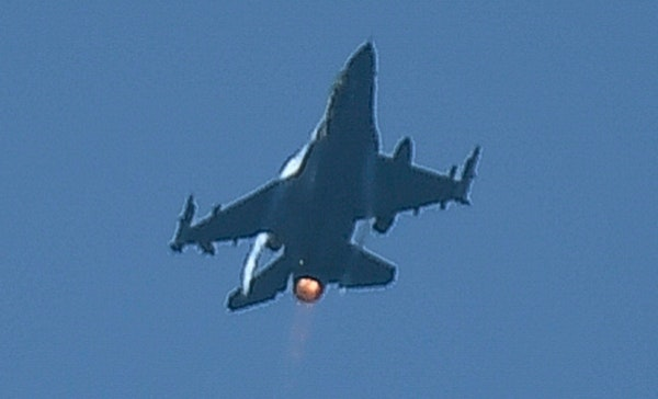 One of two F-16 jets with the 148th Fighter Wing in Duluth practiced a flyover over downtown Minneapolis just before 3 p.m. Wednesday.