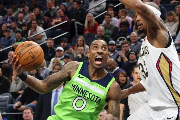 Minnesota Timberwolves' Jeff Teague, left, drives around New Orleans Pelicans' Dante Cunningham in the first half of an NBA basketball game Saturday,
