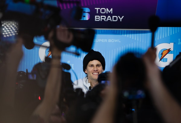 New England Patriots' Tom Brady answers questions during NFL football Super Bowl 52 Opening Night Monday, Jan. 29, 2018, at the Xcel Center in St. Pau