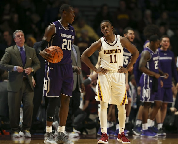Gophers guard Isaiah Washington (11) stands as the clock ran out in Minnesota's 77-69 loss to Northwestern.