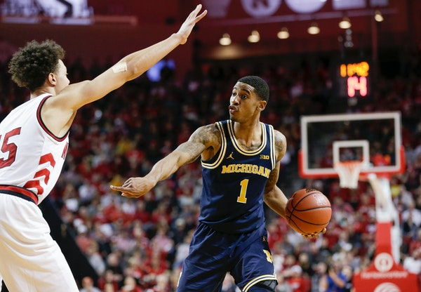Michigan's Charles Matthews is defended by Nebraska's Isaiah Roby.