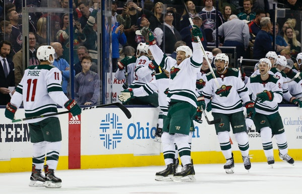 Minnesota Wild players celebrate their win over the Columbus Blue Jackets in an NHL hockey game Tuesday, Jan. 30, 2018, in Columbus, Ohio. The Wild be