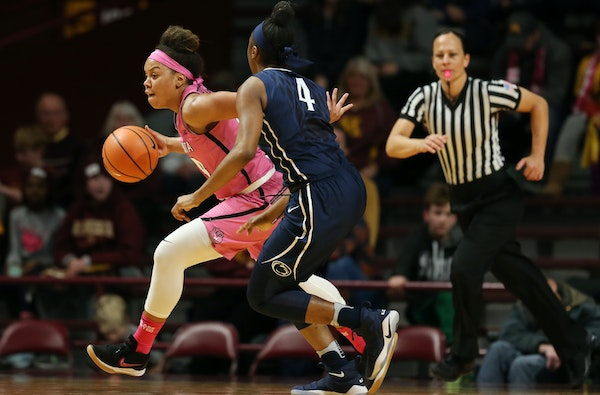Gophers guard Gadiva Hubbard dribbled past Penn State guard Siyeh Frazier in the second half at Williams Arena on Sunday. Hubbard led all scorers with