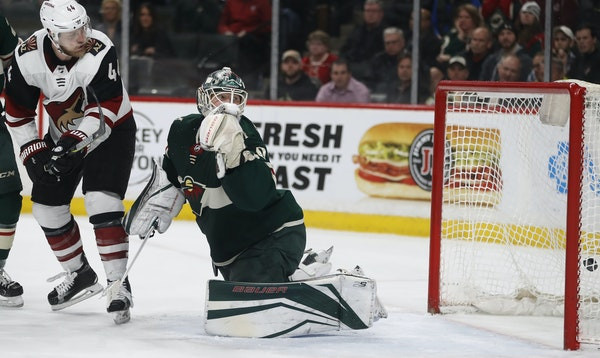 As Coyotes defenseman Kevin Connauton looked on, Clayton Keller's shot sailed past Wild goalie Devan Dubnyk for the game-winning goal in OT.