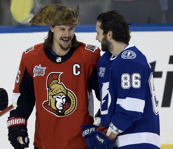 Ottawa defenseman Erik Karlsson, left, came to Saturday's skills competition dressed as a pirate. Appropriate, as he'll likely make out like a pir
