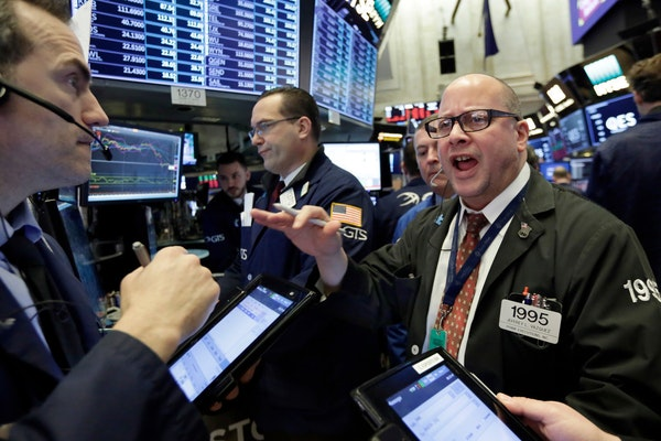 The Dow Jones industrial average closed up Friday by more than 300 points after a week of volatile moves that saw two days suffer 1,000-point losses.