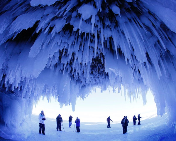 After trekking on frozen Lake Superior, visitors admire the striking Apostle Islands Ice Caves.