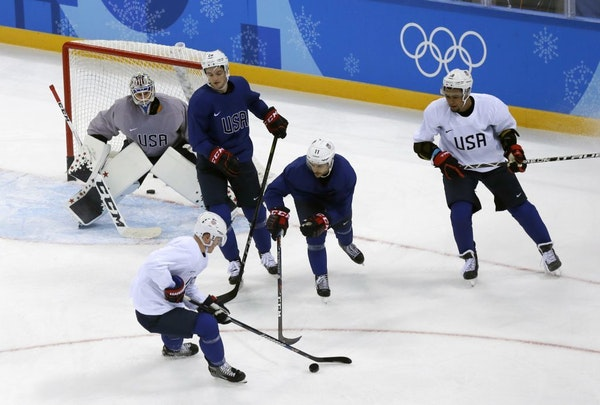 Members of the United States men's hockey team practice ahead of the 2018 Winter Olympics in Gangneung, South Korea, Friday, Feb. 9, 2018.