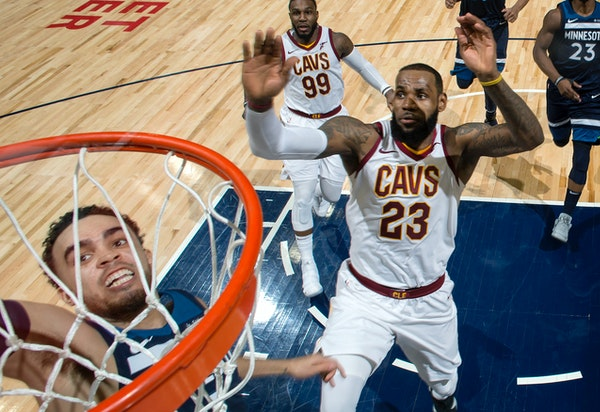 Wolves point guard Tyus Jones dunked the ball while being chased by the Cavaliers' LeBron James on Jan. 8.