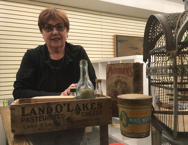 Lin Strong, a director of the Chisago County Historical Society, showed artifacts that will be on display in the new headquarters in Lindström, Minn.