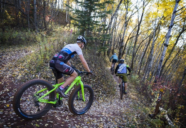 Mountain bikers make their way down a trail at Cuyuna Country State Recreation Area.