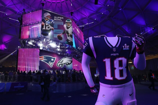 A Patriots mannequin for fans to pose in stood near the line for photos of the Vince Lombardi Trophy at the Super Bowl Experience.