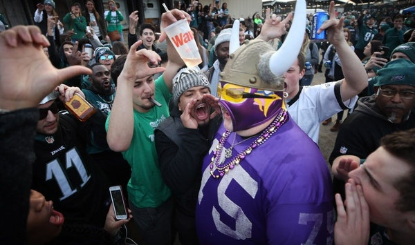 Vikings fan Andrew Grein of Edina, walked through a crowd of hostile Eagle fans before kickoff of the NFC Championship game at Lincoln Financial Field