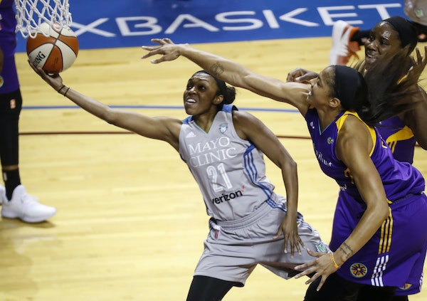 Minnesota Lynx guard Renee Montgomery (21) shoots as Los Angeles Sparks forward Candace Parker (3), right front, defends during Game 2 of the WNBA fin