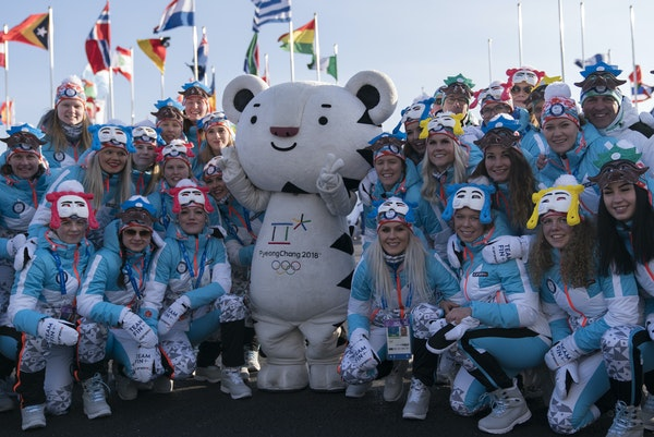 """Members of the Finnish Olympic team posed for photos with the Olympic mascot — a white tiger named """"Soohorang"""" — at a welcome ceremony on Wedn"""