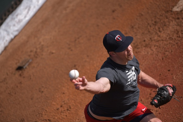 Twins pitcher Trevor May warmed up in the bullpen on Tuesday at Hammond Stadium in Fort Myers
