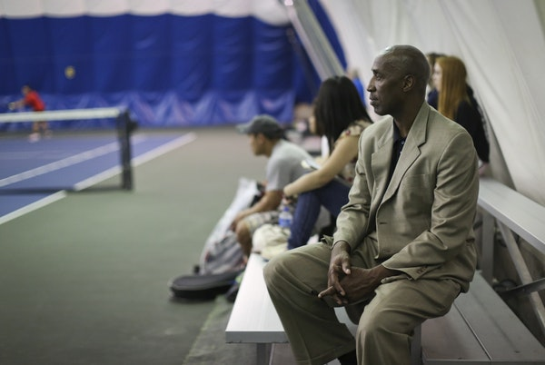 Minneapolis Public Schools Athletic Director Trent Tucker watched a tennis match in 2013. He resigned from his post on Thursday.