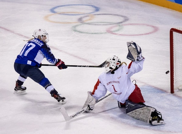 Jocelyne Lamoureux-Davidson (17) shot the puck past Goalie Valeria Tarakanova (1) for a goal in the second period.