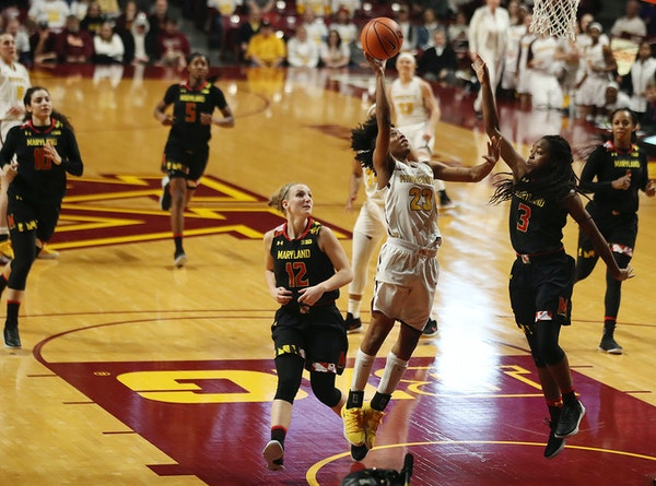 Minnesota Golden Gophers guard Kenisha Bell (23) scored a basket over Maryland Terrapins guard Channise Lewis (3) in the first half at Williams Arena