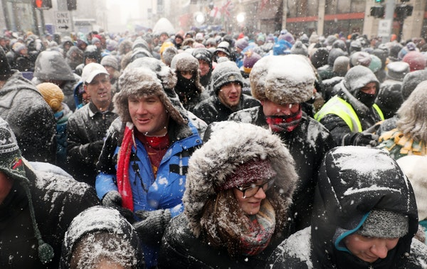 A crowd made its way down Nicollet Mall after Levi LaVallee leapt a snowmobile over the street in a snowmobile Feb. 3. Super Bowl Live attendees took