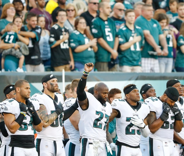 Philadelphia Eagles strong safety Malcolm Jenkins raises his fist during the national anthem before the Eagles play the Miami Dolphins in a preseason