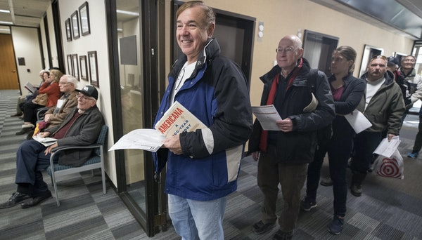 Joe Antonucci waited in line to pre-pay his 2018 property tax Wednesday December 27, 2017 in Minneapolis.