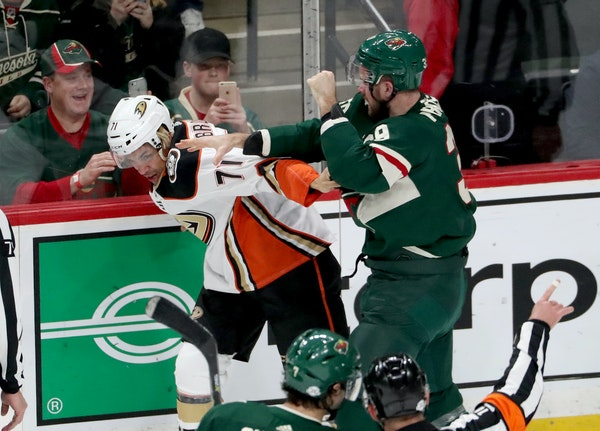 The Minnesota Wild's Nate Prosser (39) and Anaheim's J.T. Brown (71) fight during the first period.