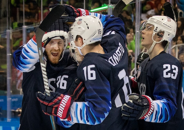 Ryan Donato (16) celebrated with Team USA teammates after scoring a goal in the third period against Slovakia. ] CARLOS GONZALEZ � cgonzalez@startri
