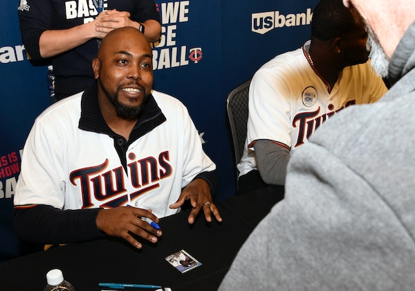 New Twins pitching coach Garvin Alston signed an autograph during TwinsFest at Target Field in January.