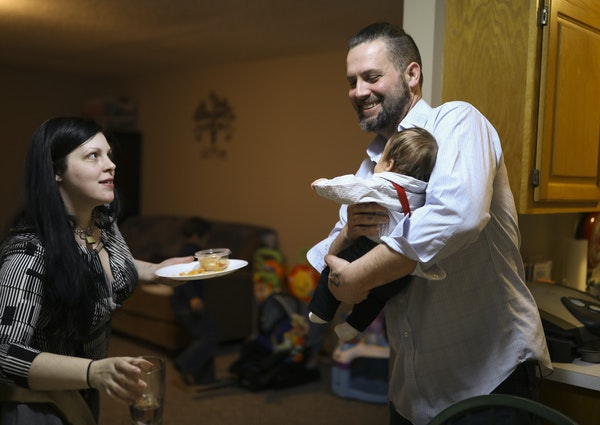Tiffany Birch, left, and Rob Spain, with their 7-week-old son, Ayden, cleared the kitchen table in their new home.