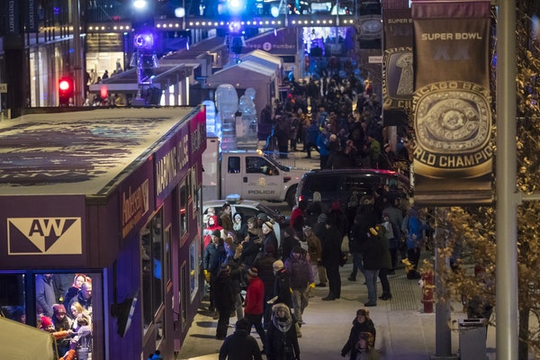 A crowd walked through the Super Bowl Live events on Nicollet Mall on Friday night in Minneapolis.