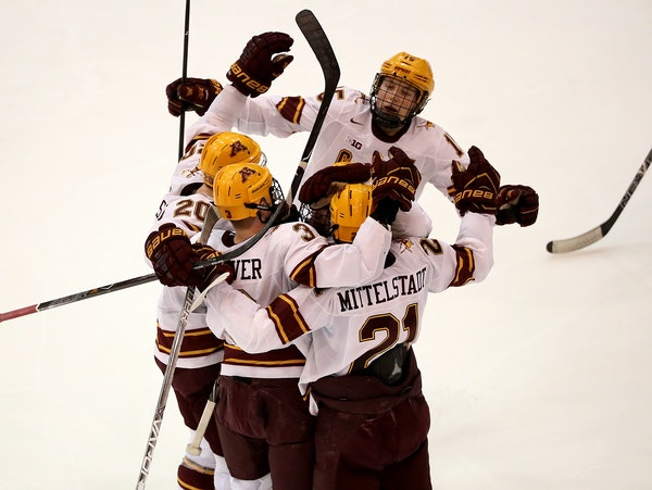 Gophers players celebrated a goal by Jack Glover against Ohio State in the second period Friday