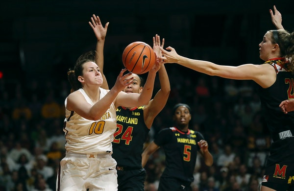 Gophers center Jessie Edwards pulled down a rebound over Terrapins forward Stephanie Jones (24) and guard Sarah Myers in the second half at Williams A
